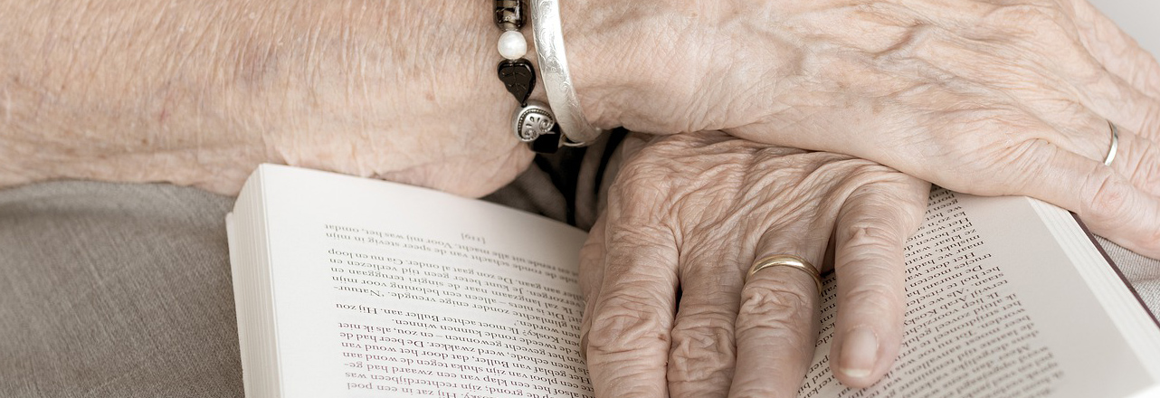 Older person holding book